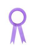 Purple fabric award ribbon isolated on white. Background Royalty Free Stock Image