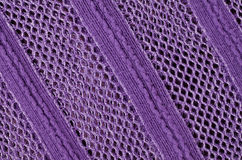 Purple fabric with crochet work Royalty Free Stock Photos