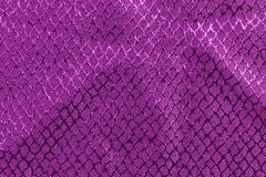 Purple fabric with embossed textures Stock Image