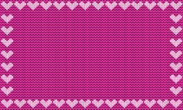 Purple fabric knitted background framed with knit hearts. Royalty Free Stock Image