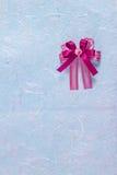 Purple fabric ribbon on blue mulberry paper Stock Photo