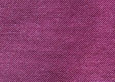 Purple fabric texture background. Purple fabric texture useful as a background Royalty Free Stock Photo
