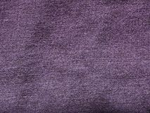 Purple fabric texture background. Purple fabric texture useful as a background Royalty Free Stock Images