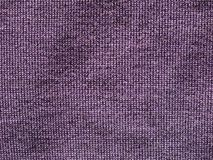 Purple fabric texture background. Purple fabric texture useful as a background Stock Photos