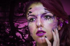 Purple fairy. Make up with a forest background