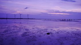 Purple feel to shoot the sillouette of Wind turbine array at Gaomei Wetland royalty free stock image