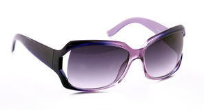 Purple feminine sunglasses Stock Images