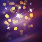 Purple Festive Christmas background. Abstract background with bokeh defocused lights and stars Stock Photo