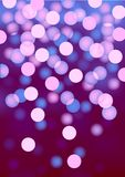 Purple festive lights, vector background. Vector background defocused festive lights, no size limit Royalty Free Stock Photo