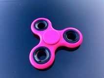 Purple fidget spinner stress relieving toy Stock Photography
