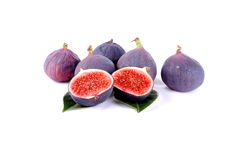Purple figs over leaves on white Stock Photo