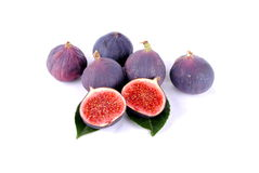 Purple figs over leaves on white Stock Image