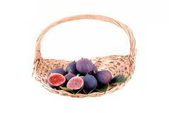 Purple figs in a straw basket Stock Photos