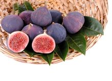 Purple figs in a straw basket Stock Photography