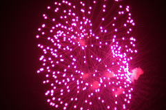 Purple Fireworks. In colorful shades of red and pink royalty free stock photos