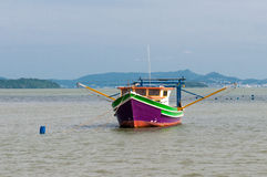 Purple Fishing boat. A small purple fishing boat anchored in the bay of Governador Celso Ramos, a small city in Souther Brazil Stock Images