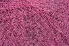 Purple fishnet background Royalty Free Stock Image