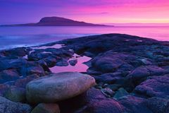 Purple fjord. A colorful sunset in the Faroe Islands Stock Photography