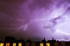 Purple flashes. Thunder flashes in the sky over Amsterdam during a heavy thunderstorm in summer stock photos
