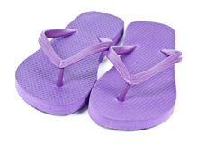 Purple Flip Flops. Pair of Purple flip flops isolated on white royalty free stock photo