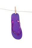 Purple flipflop sandal on white Stock Photography