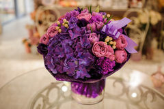 Purple flower bouquet composition  on table Royalty Free Stock Photo