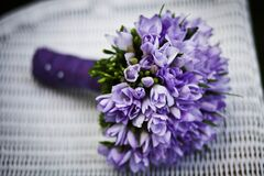 Purple Flower Bouquet on White Woven Chair Royalty Free Stock Photography