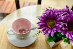 Purple flower pot and empty coffee mug Stock Photos