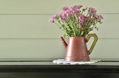 Purple flower in vintage vase on piano Stock Photography