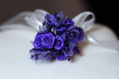 Purple flower on wedding cake. Royalty Free Stock Image