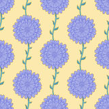 Purple flowers. Seamless pattern with violet flowers on a yellow background Stock Images