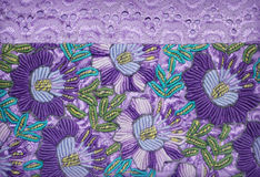 Purple flowers embroidery. Floral embroidery and batiste border Stock Photography