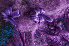Purple flowers with fibers and paper, closeup royalty free stock photo