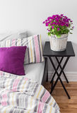Purple Flowers In A Bright Bedroom Stock Image