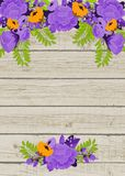 Purple and orange flowers on wooden background Stock Images