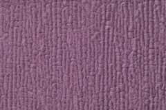 Purple fluffy background of soft, fleecy cloth. Texture of textile closeup Royalty Free Stock Image