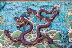 Purple flying dragon on the wall Stock Photo