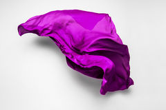 Purple flying fabric Royalty Free Stock Images