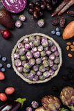 Purple food on dark background royalty free stock images