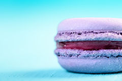 Purple French Macaroon On Blue Stock Photos