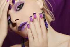 Purple French manicure and makeup. Purple French manicure and makeup on a young woman royalty free stock photos