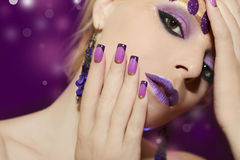 Purple French manicure and makeup. Royalty Free Stock Photo