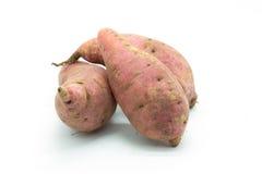 Purple fresh potato on white background Stock Photos