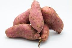 Purple fresh sweet potato on white Royalty Free Stock Photos