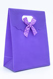 Purple gift bag. On a white background Stock Photos