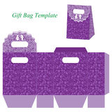Purple gift bag with floral pattern and bow. Vector illustration of a box and a box template Stock Image