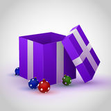 Purple gift box with Cristmas toy Stock Photos