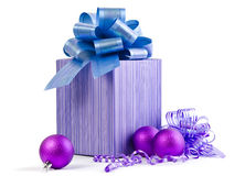 Purple gift box with a ribbon bow Royalty Free Stock Photos