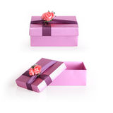 Purple gift box with ribbon flower Stock Images