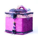 Purple gift box with a rose isolated. Stock Photo